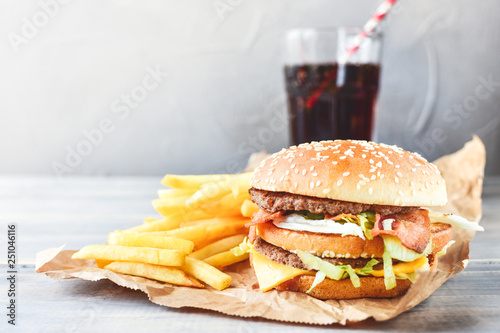 Fototapeta double cheeseburger with fries