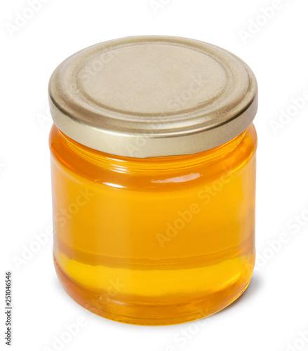 Carta da parati Glass jar full of sweet honey isolated on white background