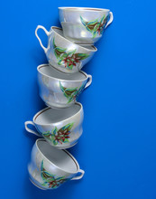 Retro Ceramic Stack Of Cups On Blue Background. Top View.