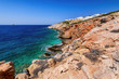 Palm beach (Agia Irini) on Paros island, Greece. Picturesque greek beach with huge palms in Cyclades Islands