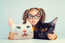 Beautiful Cute Little Girl Looking Up And Hugging To Cat Shaped Pillows