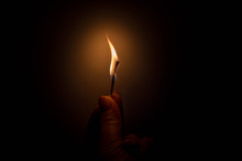 Burning Match In Female Hand In The Dark