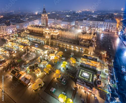 Fototapeta Krakow Poland main square with cloth hall and Christmas fairs aerial view obraz