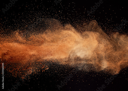 Valokuva Cocoa powder explosion on black background.