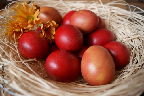 Fotografiet  Easter background with red eggs