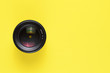 canvas print picture - Camera lens on yellow background