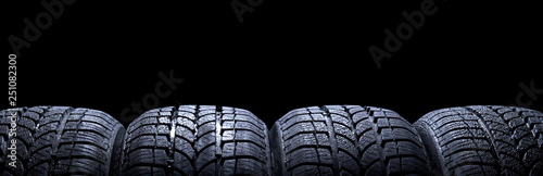 Photographie Car tires isolated on black background