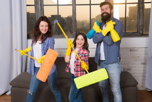 Expert House Cleaning Service You Can Trust. Family Cleaning House. Happy Family Hold Cleaning Products. Mother, Father And Daughter Cleaning House. Clean House. Everything Should Be Perfect