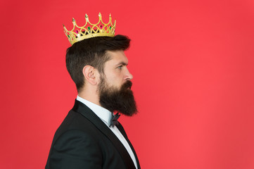 King attribute. Narcissistic king. Self confidence concept. Handsome hipster formal suit. Elite society. Feeling superior. Man bearded guy in tuxedo golden crown symbol of monarchy. King ceremony