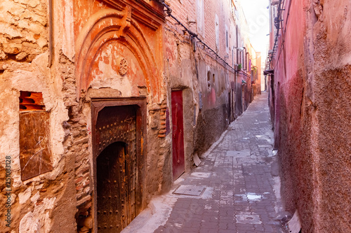 Fotografie, Obraz  Colorful ancient old and narrow street in medina of Marrakech, Morocco, Africa