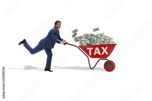 Obraz na plátně Businessman pushing wheelbarrow full of money in tax concept
