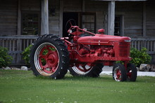 Old Red Tractor In Field