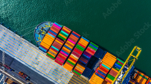 Foto auf Leinwand Rotterdam Container cargo freight ship with working crane bridge discharge at container terminal, Aerial top view container ship at deep sea port.