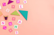 Kids toys on pink background Top view Flat lay Copy space