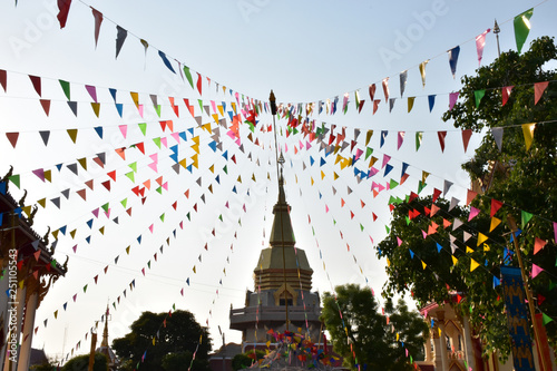 Fotografía  Colorful triangle flags fasten in line with pole in the temple ,  these are decorations in Song kran festival in Thailand