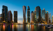 Dubai Marina Modern Skyscrapers And Luxury Yachts At Blue Hour