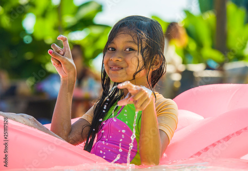 Obraz na plátně  lifestyle outdoors portrait of young happy and cute female child having fun with