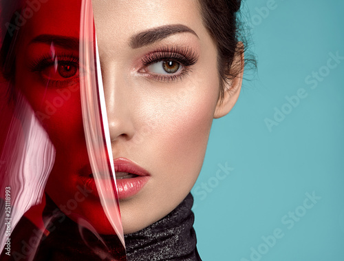 Beautiful fashion woman with  a colored  items.  Attractive white girl with living coral makeup. Wall mural