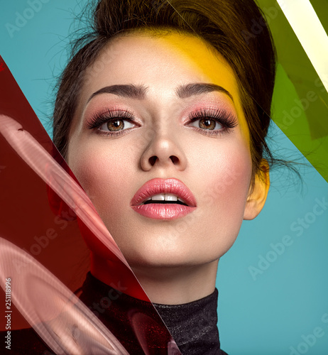 Beautiful fashion woman with  a colored  items.  Attractive white girl with living coral makeup.