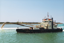 Dredge Boat Removing Sand And Silt From The Bottom. Dredger Ship Works.Pumping Sand.