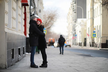 Young Couple Walking Through T...