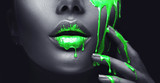 smudges drips from the face lips and hand, green liquid drops on beautiful model girl's mouth, creative abstract makeup. Beauty woman face