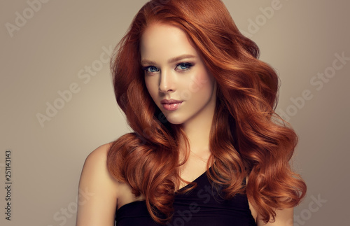 Cuadros en Lienzo Beautiful model  girl with long curly red hair