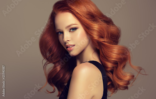 Canvas Print Beautiful model  girl with long curly red hair