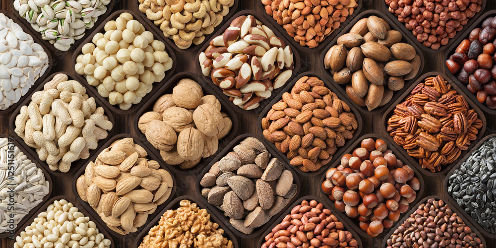 Fototapety, obrazy: assorted nuts background, large mix seeds. raw food products: pecan, hazelnuts, walnuts, pistachios, almonds, macadamia, cashew, peanut and other