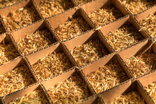 Cardboard Box Fool Of Wheat Straw In Cells