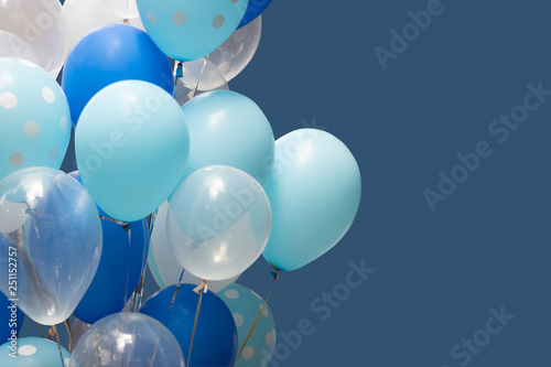 Foto op Plexiglas Groene colorful balloons on blue background. happy birthday or card concept