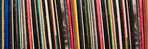 Fotografering  Collection of vinyl records covers panoramic background, vintage music concept