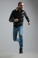 Man In Leather Jacket And Jeans Jumping