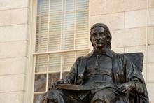 Statue Of John Harvard In The Heart Of Harvard Yard