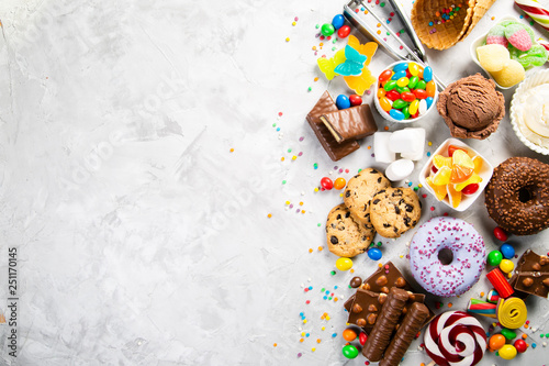 Fotomural  Selection of colorful sweets - chocolate, donuts, cookies, lollipops, ice cream