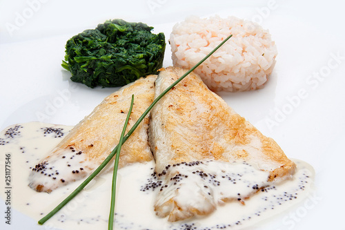 Fotografie, Obraz  Dorado fillet with spinach and rice on a white background