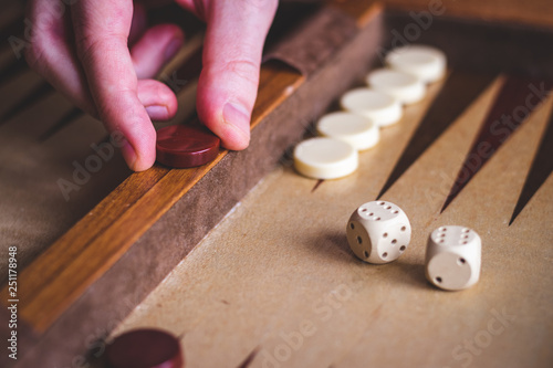 Fototapeta Playing backgammon game.