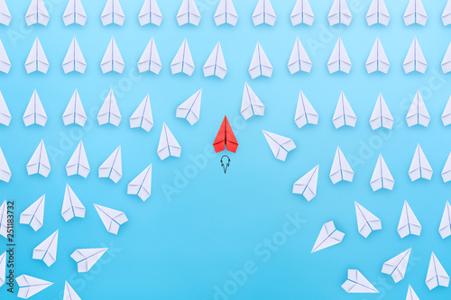 Business competition, successful businessman concept with Red paper plane flying overtake the other white paper planes on blue background Canvas Print