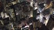 Drone shot looking down street of Hong Kong Kowloon with modern skyscraper