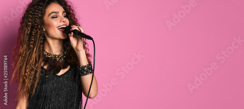 young pretty woman singing in microphone isolated close up - 251189764