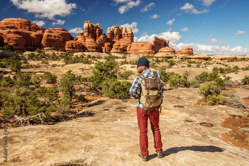 Fototapety, obrazy: Hiker in Canyonlands National park, needles in the sky, in Utah, USA