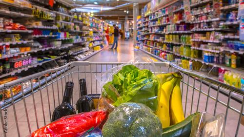 Fotografie, Obraz  Grocery cart in supermarket pano
