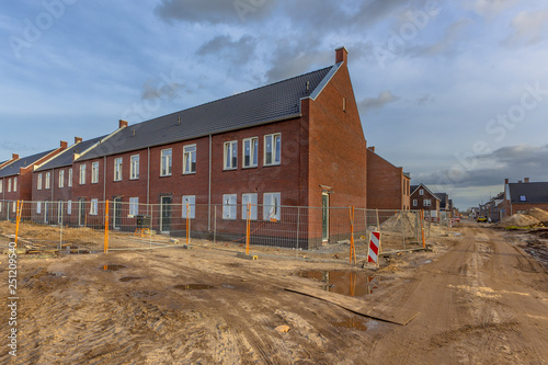 Newly built houses on building site Poster Mural XXL