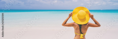 Fotografie, Obraz  Luxury beach travel - Sexy woman sunbathing on the beach with bikini beach body