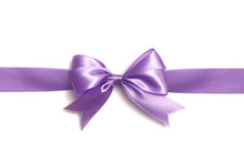 Lilac Bow And Ribbon On A White Background