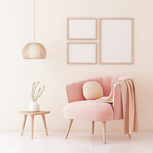 Poster Mock Up With Three Frames On Empty Beige Wall In Living Room Interior With Pastel Coral Pink Armchair, Pendant Lamp And Plant On Table. 3D Rendering.