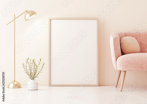 Fényképezés  Poster mock up with vertical frame standing on floor in living room interior with pastel coral pink sofa, lamp and plant in vase on beige wall background