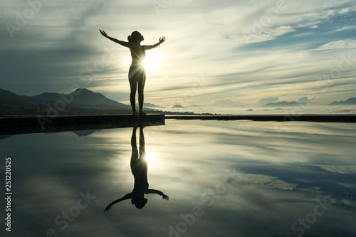 Foto auf Gartenposter Khaki Young woman enjoying fresh air at dawn time