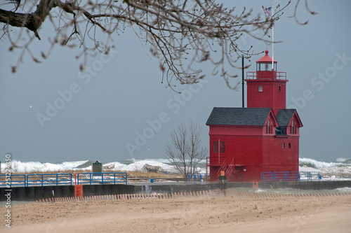Fotografie, Obraz  red lighthouse on Lake Michigan in wind storm with waves