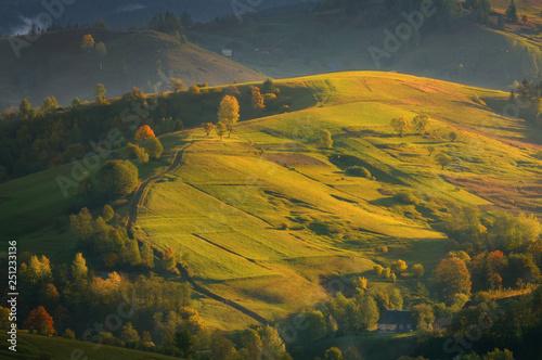 Keuken foto achterwand Rijstvelden Autumn pastoral landscape in morning light. Amazing rural landscape in autumn morning with wooden houses, fences and horses. Traditional view in Carpathians, Ukraine.